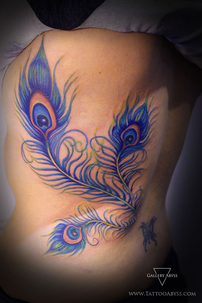 Colorful peacock feather tattoo