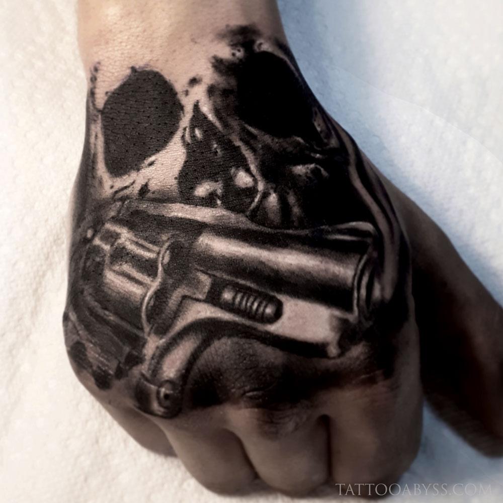 hand-gun-loudevick-tattoo-abyss